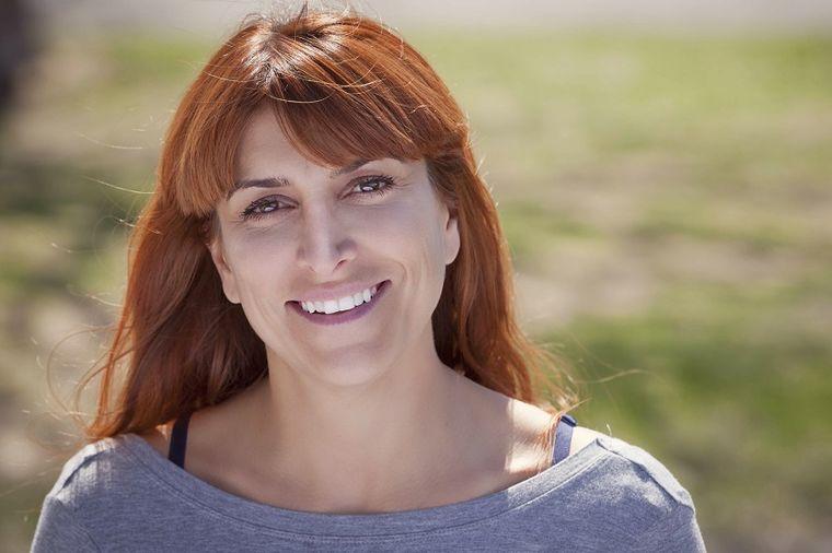 Nasmejana žena, Foto: Thinkstock